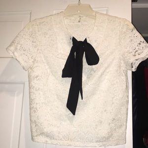 White crop lace top with black tie in the front